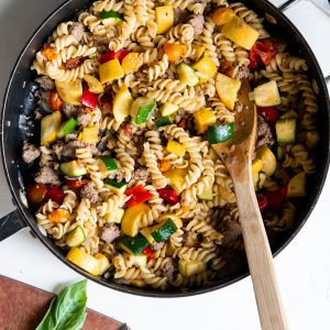 Skillet full of turkey sausage pasta primavera