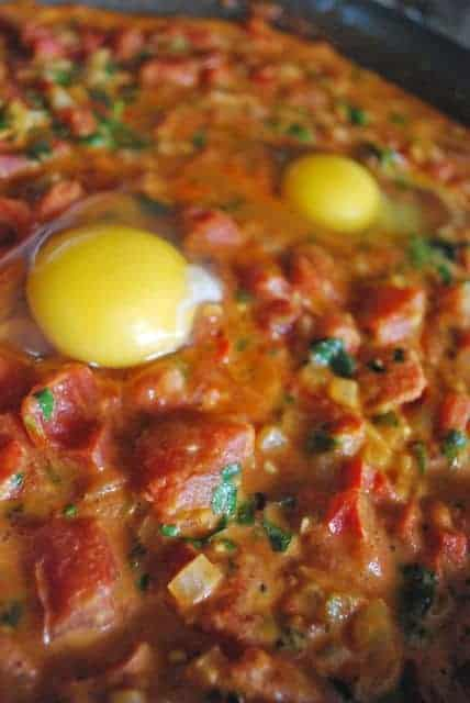 Eggs Poached in a Curried Tomato Sauce