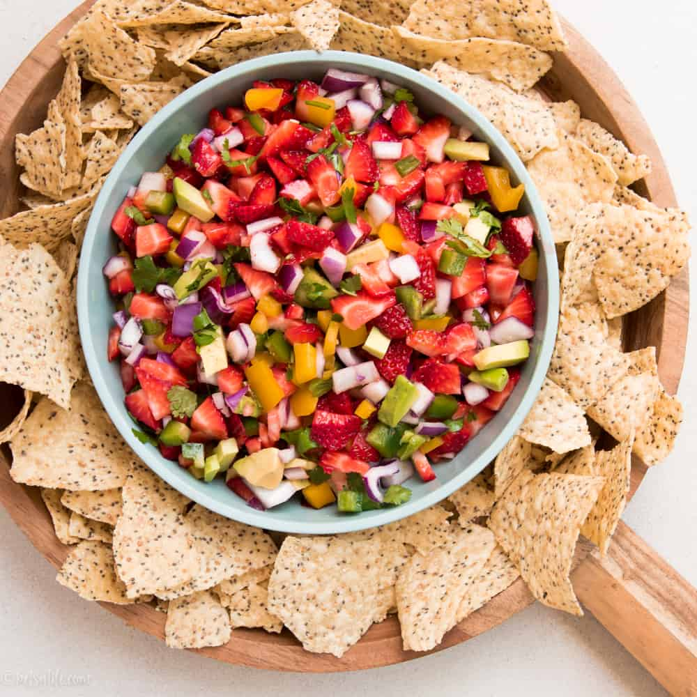 Bowl of strawberry salsa surrounded by chips