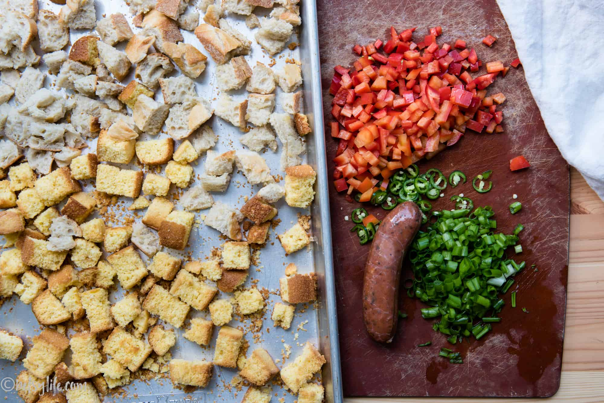 Ingredients for chorizo stuffing on a cutting board and baking sheet