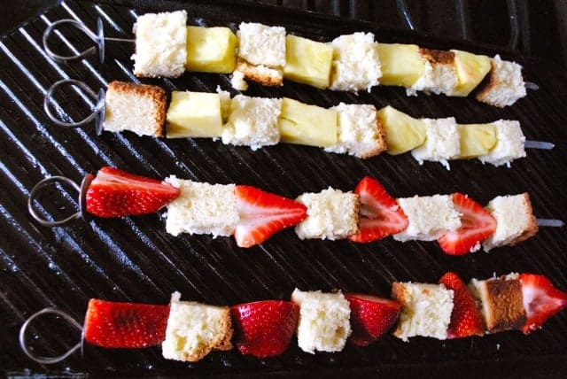 Strawberry, pineapple and pound cake skewers on the grill