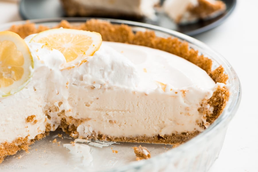 detail of inside of lemon cool whip pie with slice removed