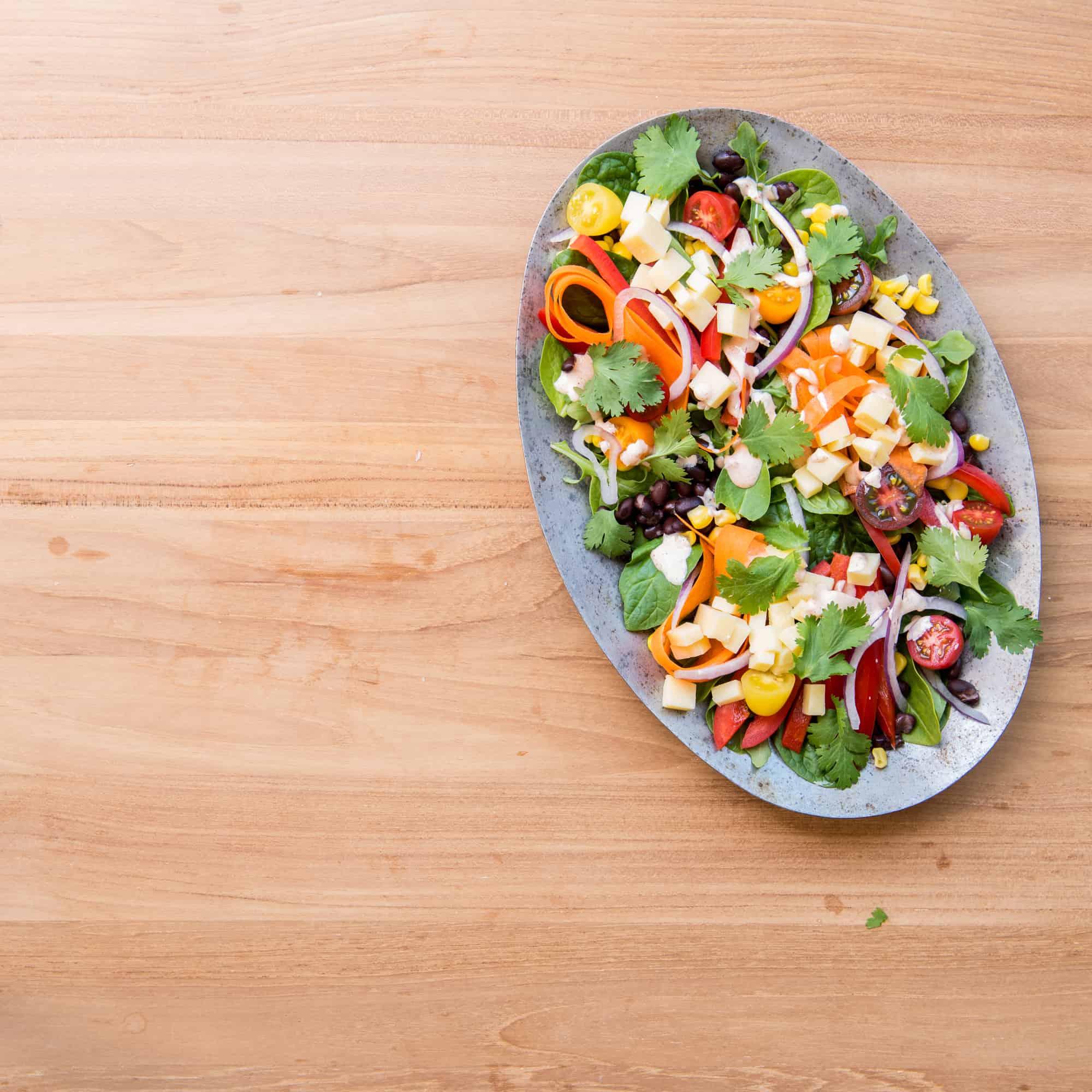 southwestern salad on a metal oval shaped plate