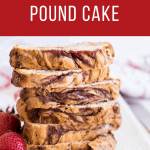 Swirled strawberry pound cake sliced and stacked on a white plate with fresh strawberries and crumbs on the side. Red banner across the top that says strawberry swirl pound cake