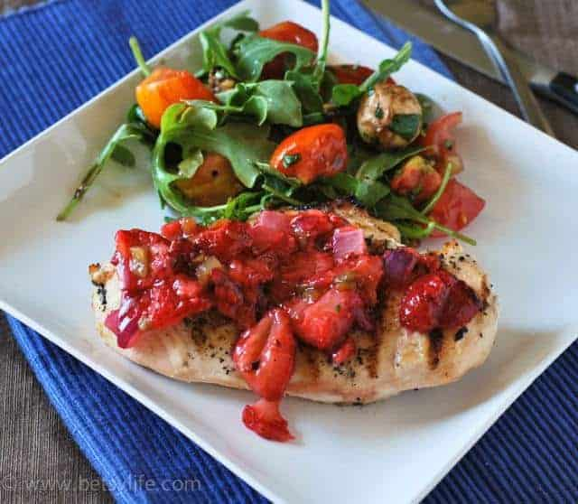 chicken breast topped with strawberry with salad