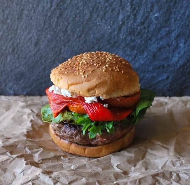 Wine Country Burger Recipe topped with roasted peppers, tomatoes, balsamic greens and creamy goat cheese.