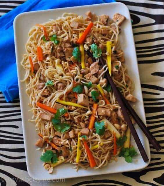 noodles with meat and vegetables on white plate
