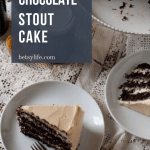 two slices of Boozy Chocolate Stout layer cake on a lace tablecloth