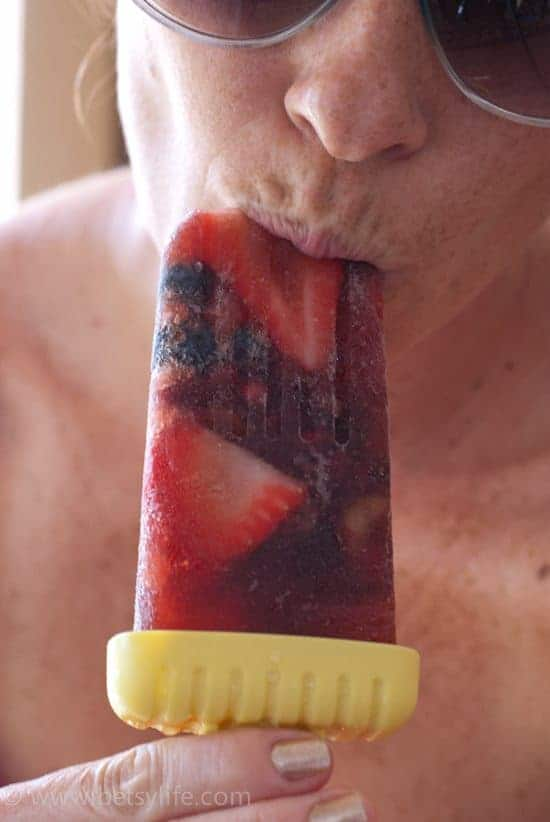 woman eating fruity popsicle