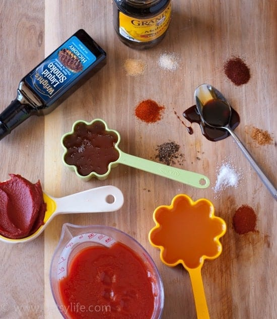 easy bbq sauce recipe. Overhead photo of all bbq sauce ingredients measured out in cups and spoons