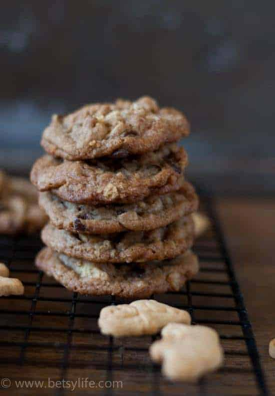 Stack of cookies on a cooling rack with two animal crackers