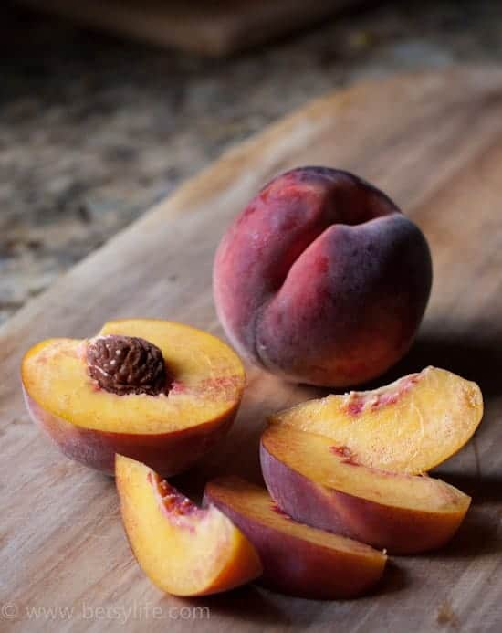 Fresh Peaches sliced on a cutting board