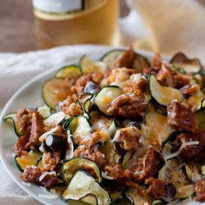 plate of sliced zucchini with meat and cheese