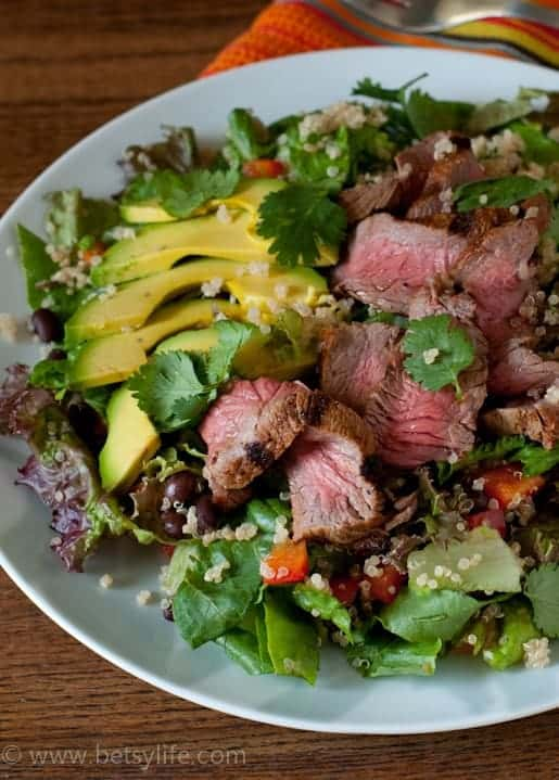 close up of chipotle steak salad with quinoa and avocado