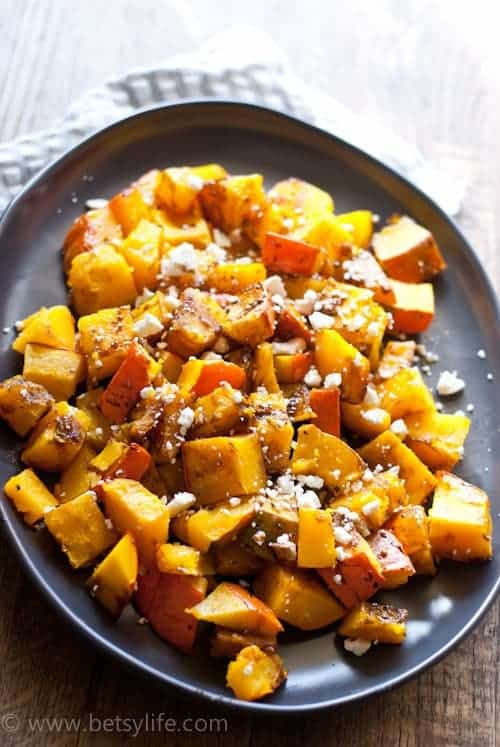 Kabocha Squash roasted with balsamic and feta on a brown serving platter