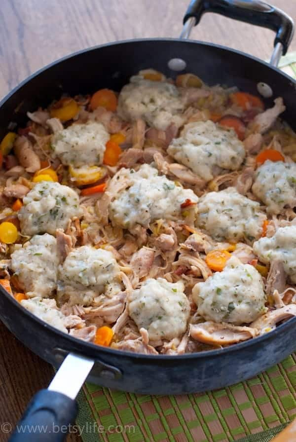 Chicken with Garlic and Herb Dumplings in a large skillet