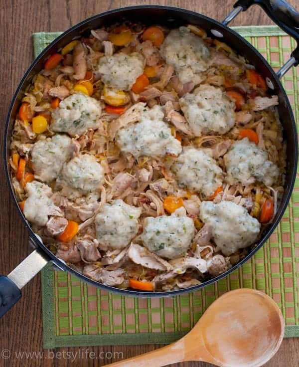 Chicken with Garlic and Herb Dumplings in a large skillet on a green placemat
