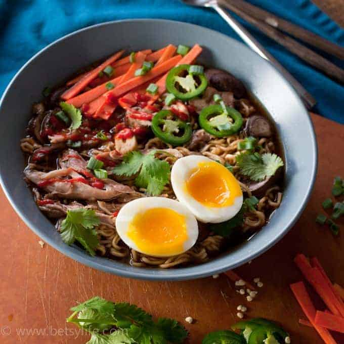 blue bowl with egg and colorful vegetables