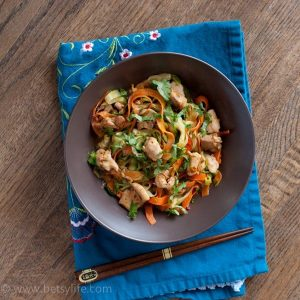 brown bowl of chicken stir fry with veggie noodles