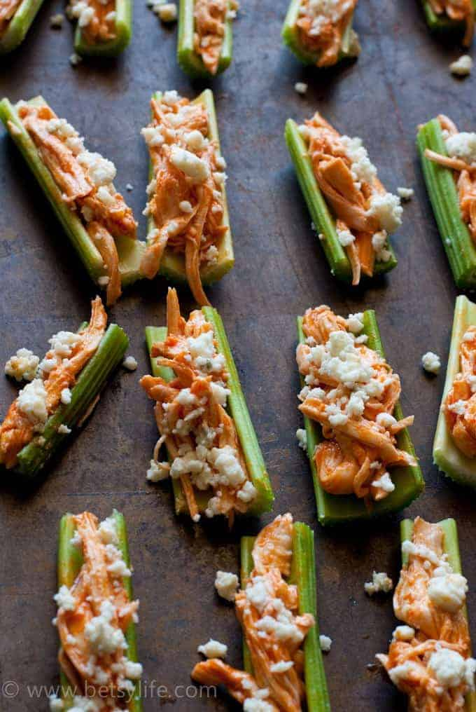 celery sticks filled with chicken and cheese crumbles