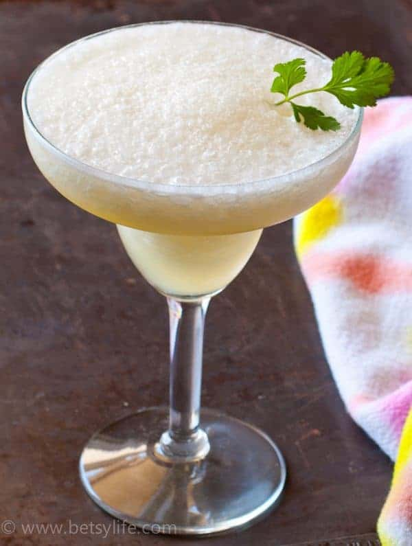 Frozen Pineapple Coconut Rum Cocktail. Made with coconut water to keep you hydrated all summer long!