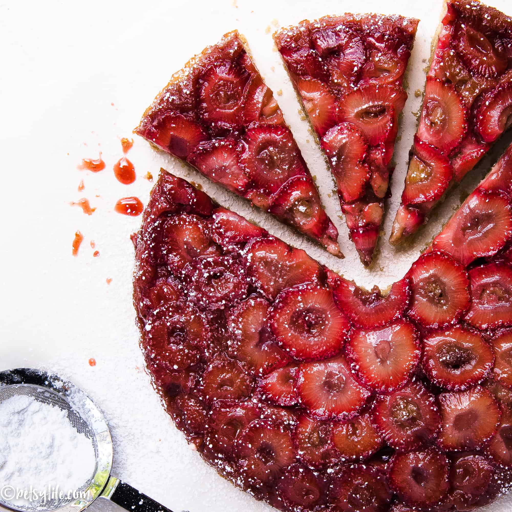 strawberry upside down cake sliced into triangular pieces