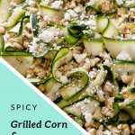 Grilled Corn and Zucchini Salad topped with crumbled feta cheese on a brown oval shaped plate