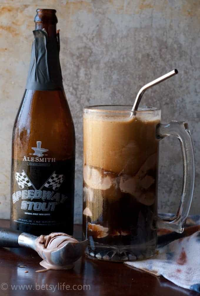 mug filled with chocolate float next to bottle of stout beer and a  melting scoop of chocolate ice cream
