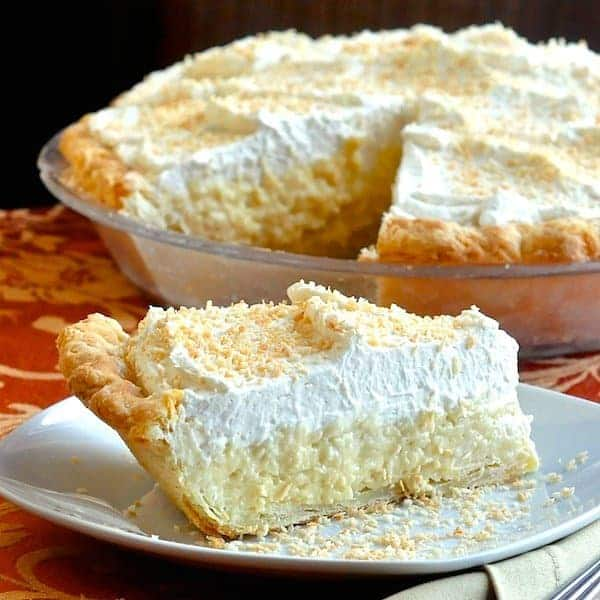 Best pie recipes ever betsylife coconut cream pie slice on a white plate with rest of pie in dish in the forumfinder Choice Image
