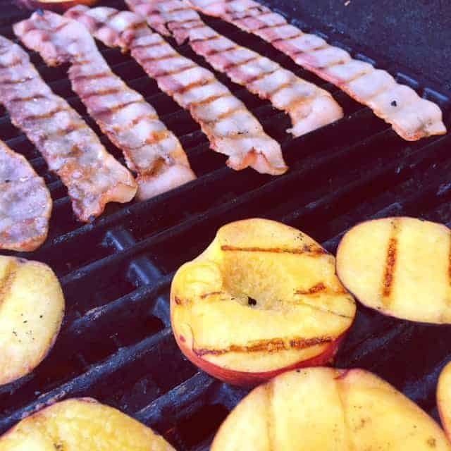 bacon and sliced peaches on a grill