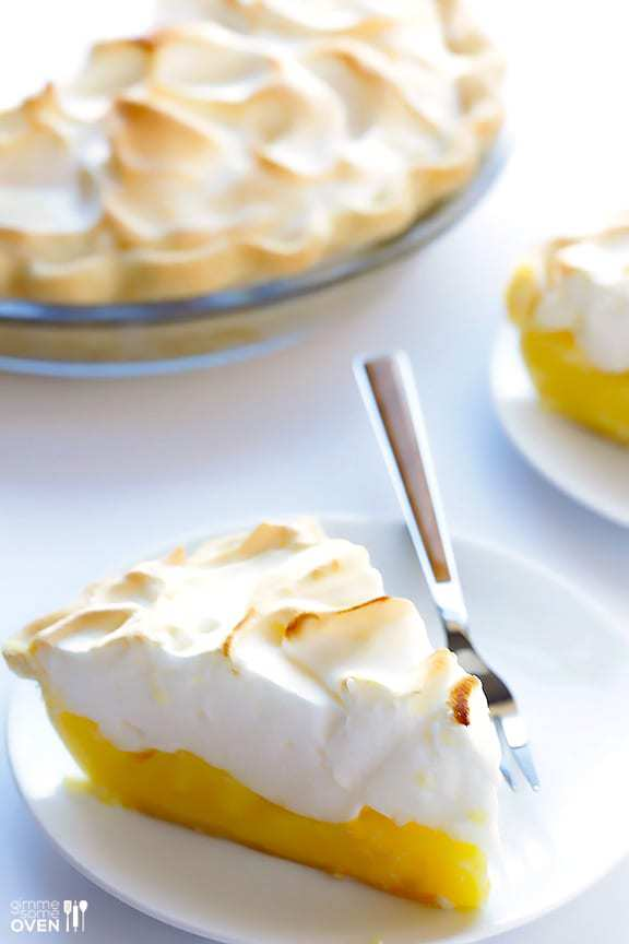 lemon meringue pie slice on a white plate