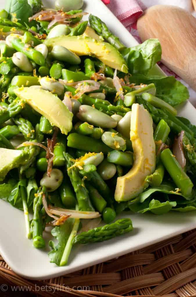 Close up of green vegetable salad. Asparagus, peas, edamame and avocado