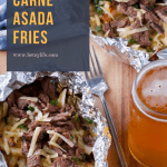meat and cheese in foil packets with glass of beer