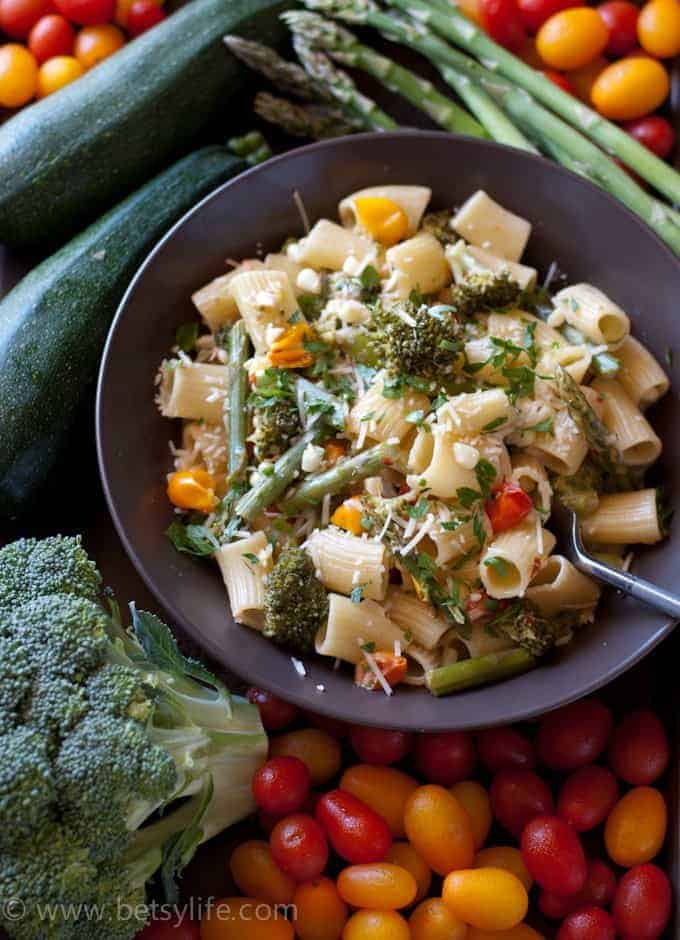 pasta and vegetables with broccoli, tomatoes, zucchini, and asparagus