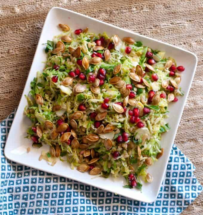Shaved Brussels Sprout and Pomegranate Salad with Toasted Pumpkin Seeds