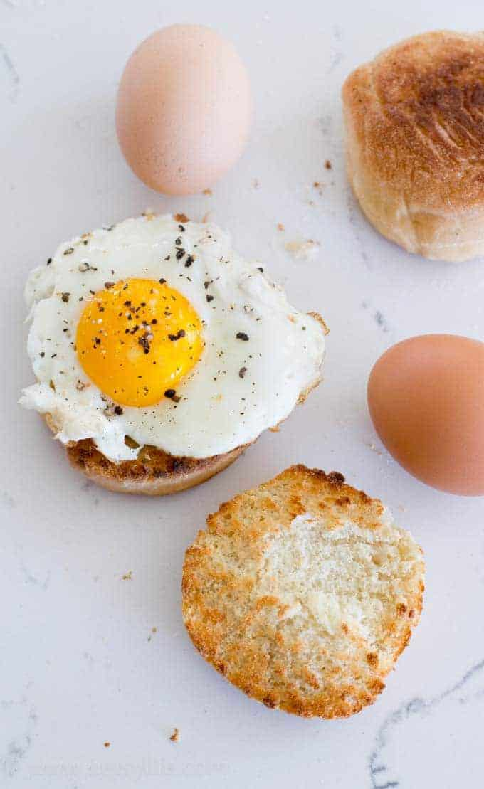 Homemade English Muffin topped with a sunny side up egg