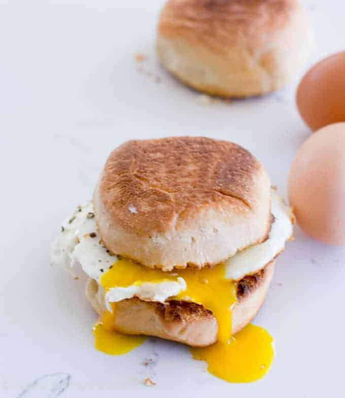 English muffin sandwich with egg yolk oozing out
