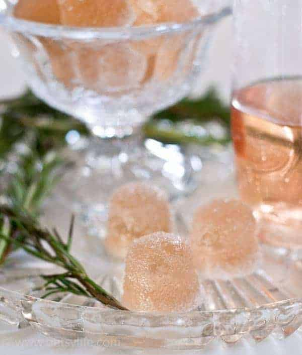 Rosé Wine Gummies on a glass plate next to pine greenery