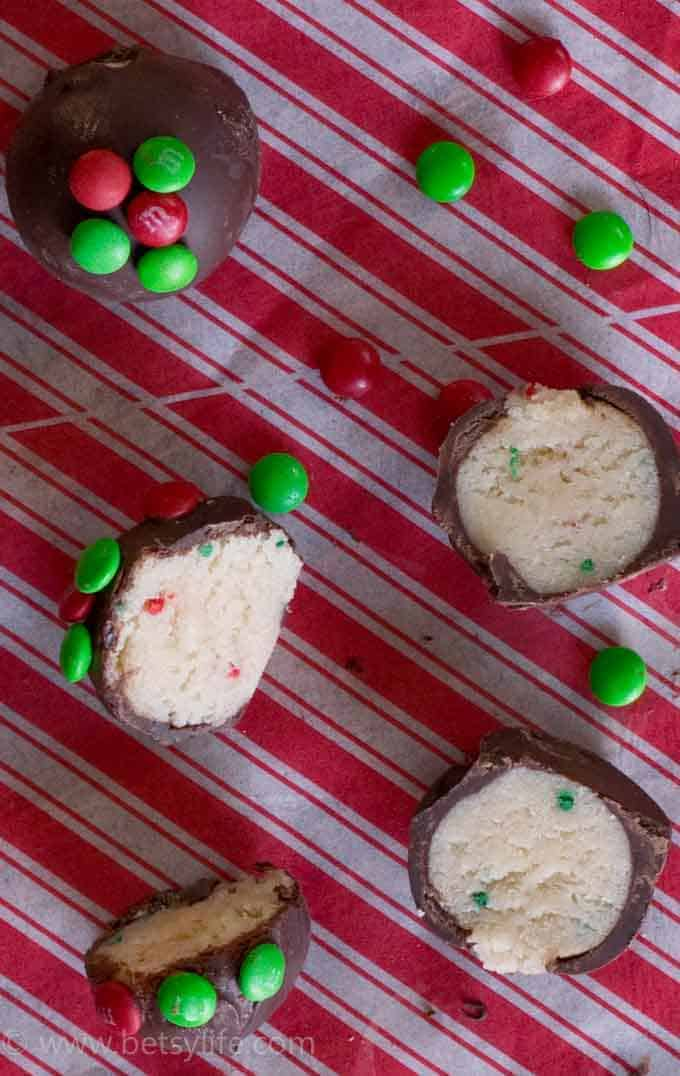 truffles with red and green candy on red-striped towel