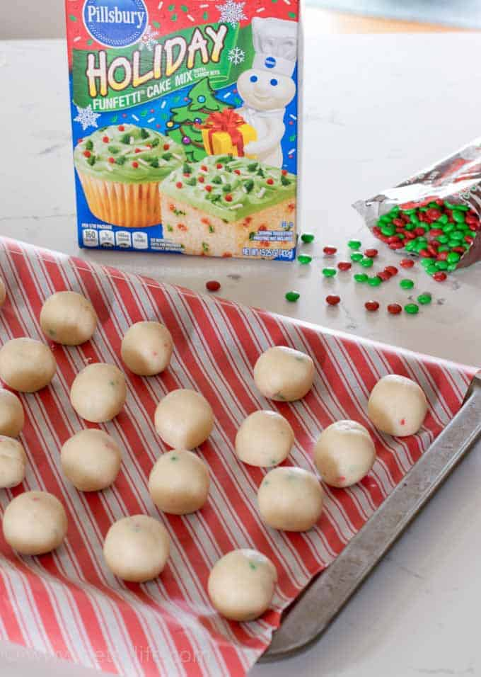 white balls of cake batter with cake mix in background