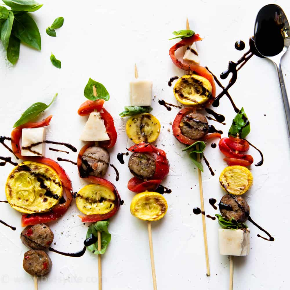 5 antipasto skewers drizzled with balsamic glaze