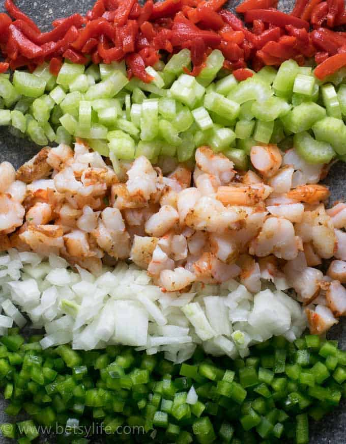rows of diced red pepper, celery, cajun shrimp, onions and jalapeno peppers