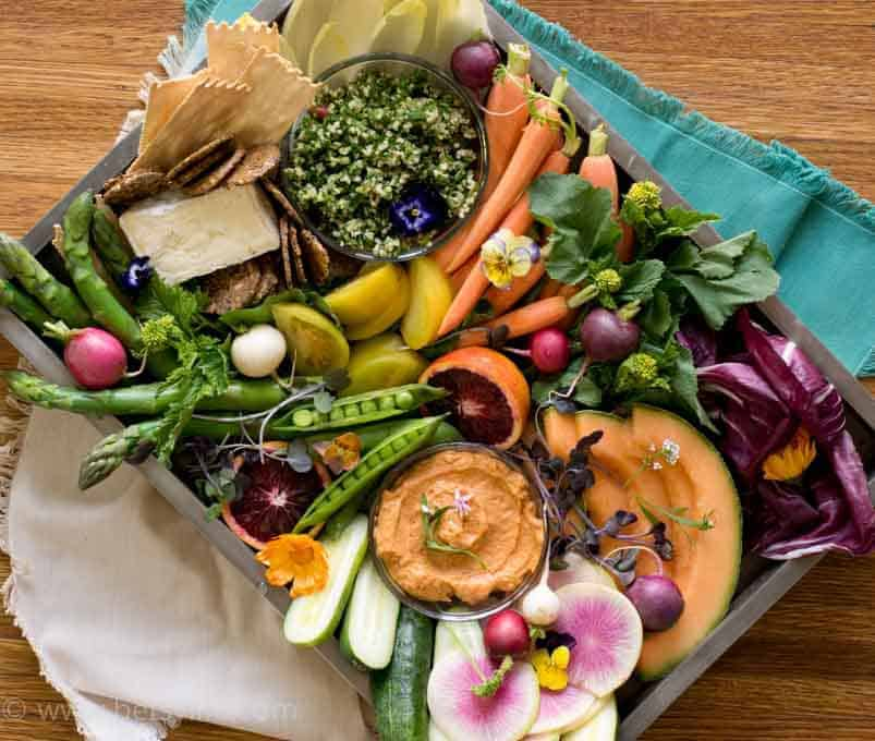 Healthy Party Food Platter on a silver rimmed tray sitting on a teal and tan napkins