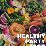 Healthy Party Food Platter featuring oranges, cantaloupe, peas, asparagus, carrots, tomatoes and radishes