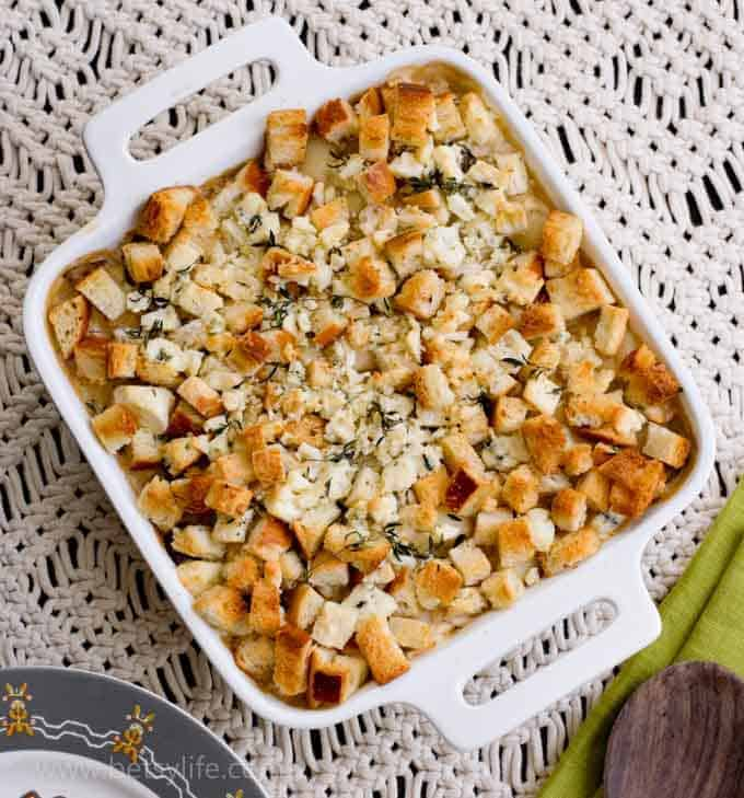 Best Ever Cheesy Gorgonzola & Gnocchi Gratin in a square dish on a macrame backgroun