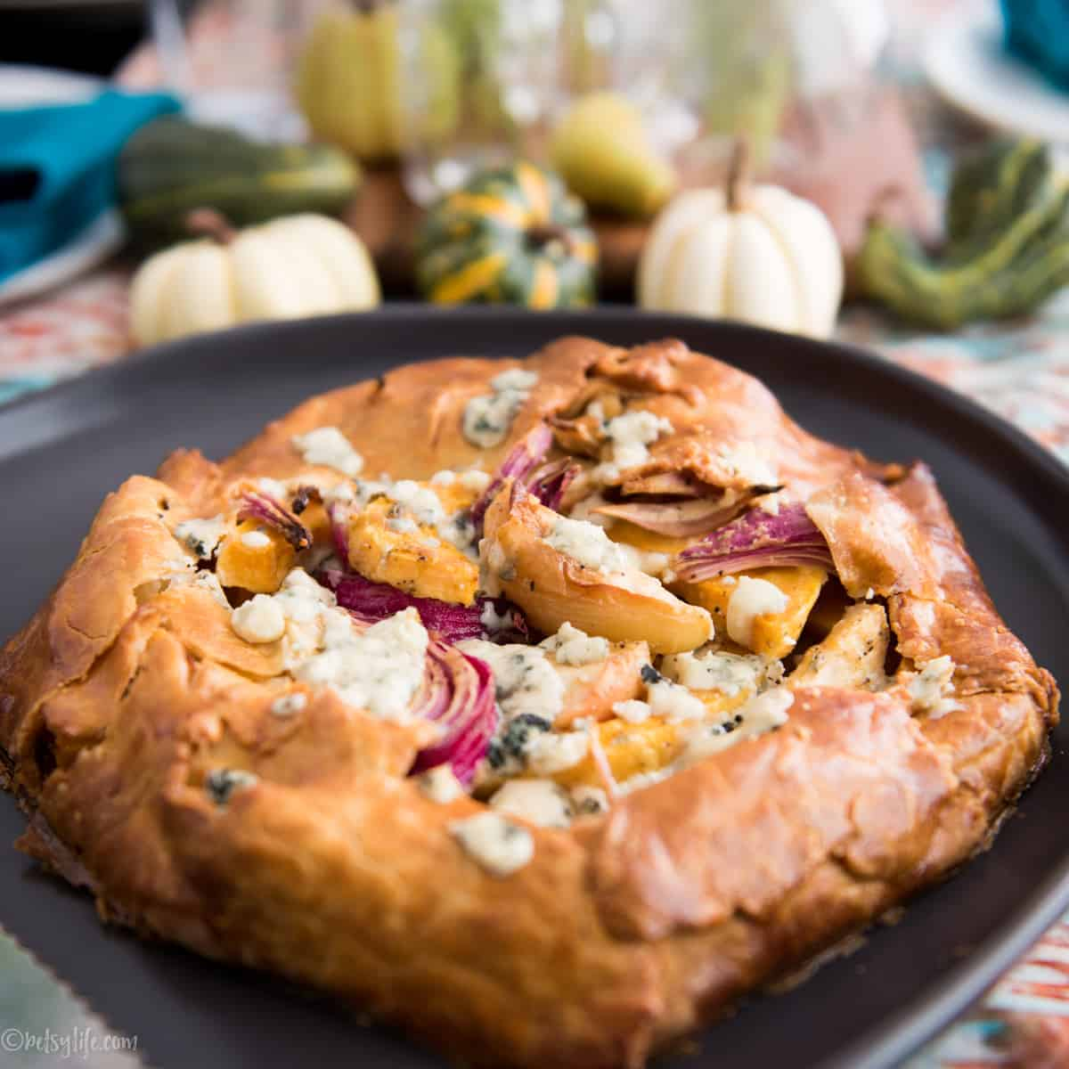 savory apple galette with red onions, butternut squash and blue cheese.