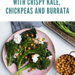 Roasted Broccolini with Crispy Kale, Chickpeas and Burrata on a pink plate next to a roasting pan, a gray linen, a measuring cup filled with chickpeas and a metal dish filled with cheese next to a wooden spoon