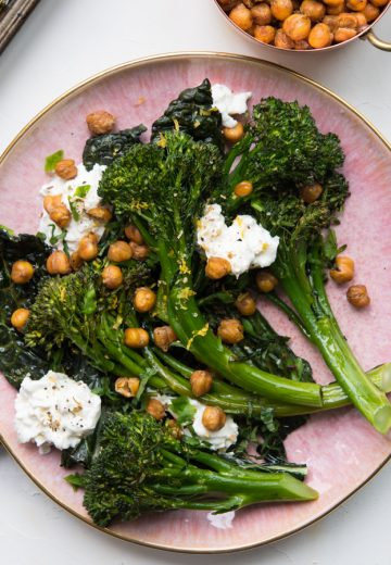 Roasted Broccolini with Crispy Kale, Chickpeas and Burrata on a pink plate