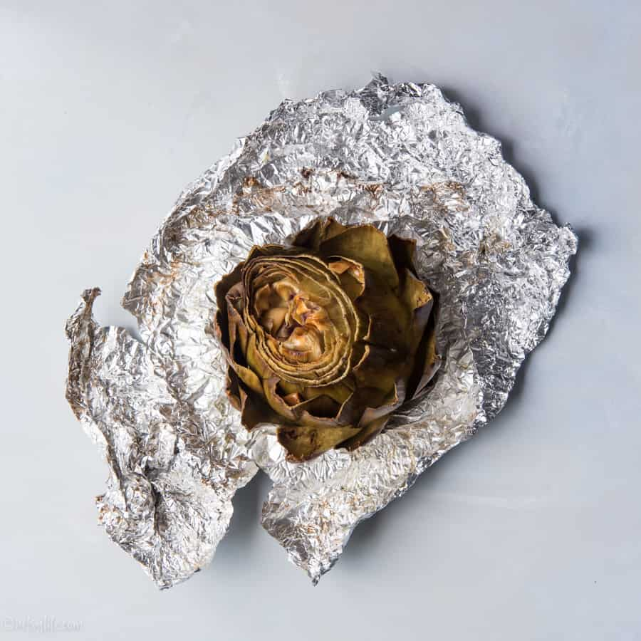 roasted artichoke in a piece of foil