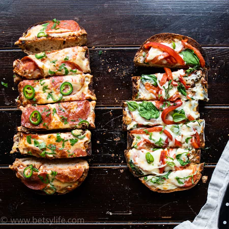 two french bread pizzas sliced into strips